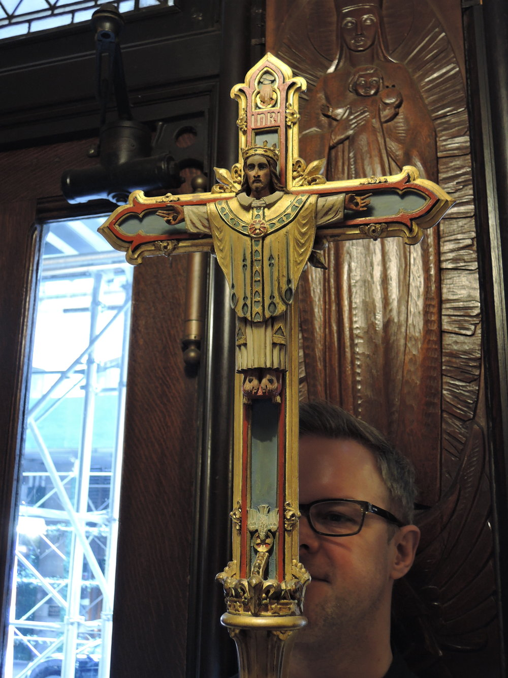 This processional cross, used on Palm Sunday and on Christ the King, was fashioned from the Saint Francis Altar cross when that altar was dismantled. Clark Mitchell was crucifer.   Photo by Br. Damien Joseph SSF