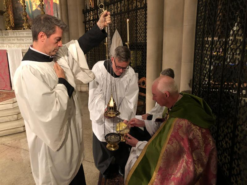 Incense is prepared at Sunday Evensong for censing the altar and the congregation while the Song of Mary is sung.   Photo by Brendon Hunter