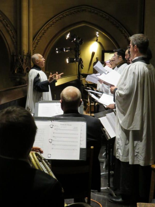 Dr. David Hurd conducts the choir and Saint Mary's Brass at the 5:00 PM service on Christmas Eve.  Photo by Br. Damien Joseph SSF