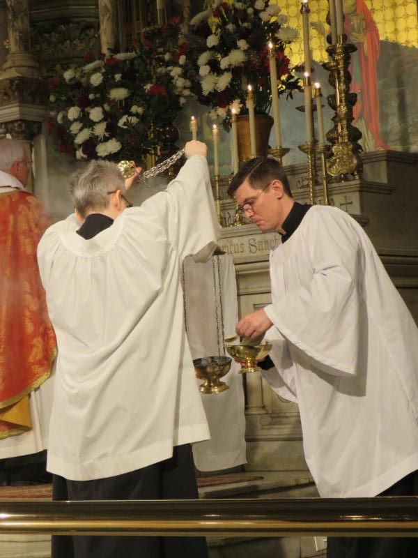 "Incense is added to the thurible as the choir sings, ""Blessed is he who comes in the name of the Lord."" Marie Rosseels served as thurifer, Brendon Hunter as MC.  Photo by Br. Damien Joseph SSF"