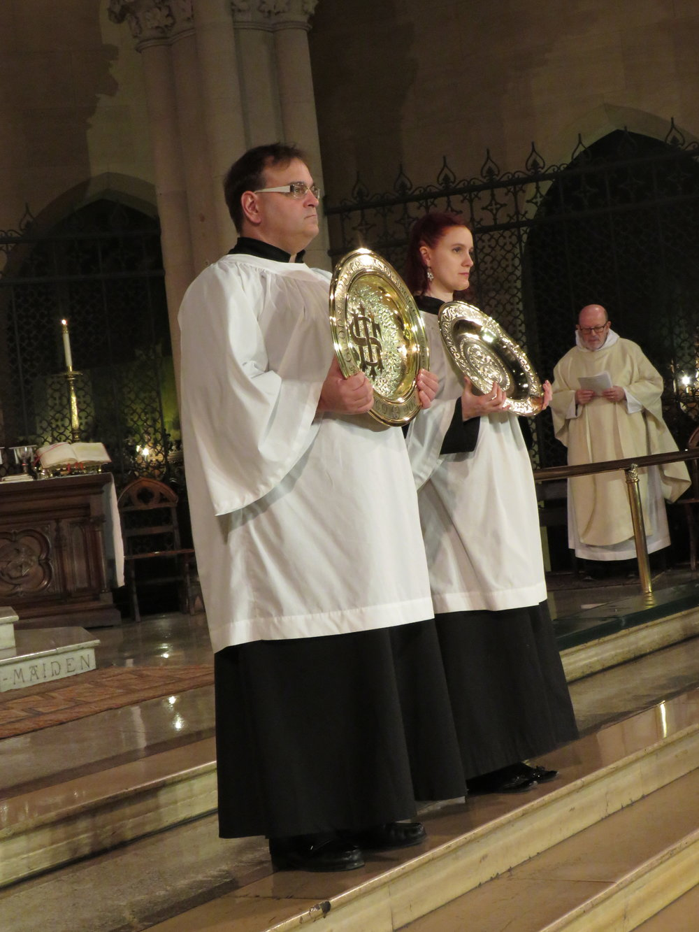 Eric Littlefield and Grace Mudd were among the servers.  Photo by Br. Damien Joseph SSF