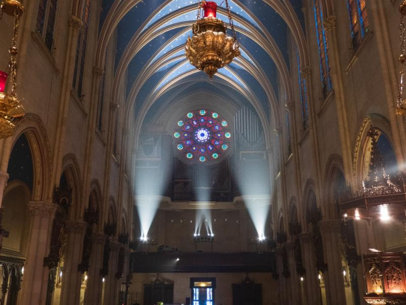 A view of the rose window, organ and the ceiling of the nave from the chancel steps.  Photo by Damien Joseph SSF