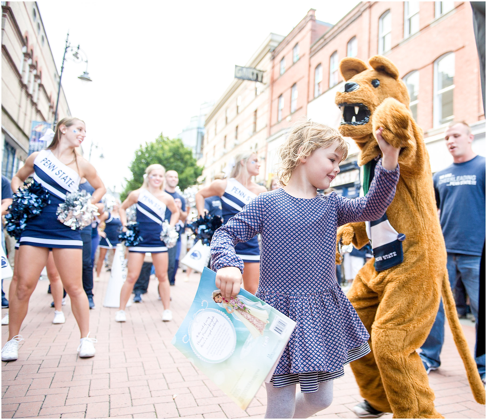The Nittany Lion dances with Ellie Kirkpatrick, 5, of Dublin during a pep rally on Thursday, Aug. 28, 2014. Photo by Hannah Byrne