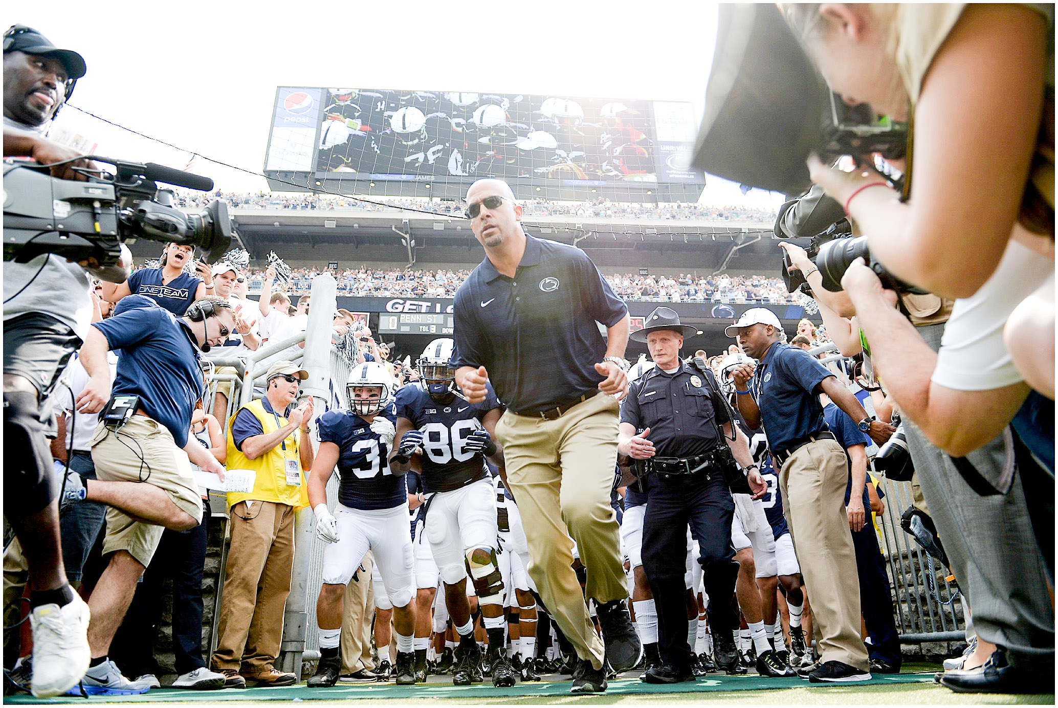 Head coach James Franklin leads his team onto the field for the first time on Saturday, September 6, 2014. Photo by Hannah Byrne