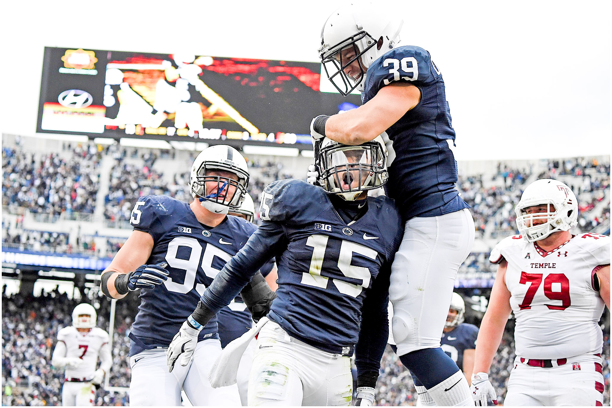 Carl Nassib (95), Grant Haley (15) and Jesse Della Valle (39) celebrate in the endzone after Haley's touchdown against Temple on Saturday, November 15, 2014. Penn State defeated Temple 30-13. Photo by Hannah Byrne