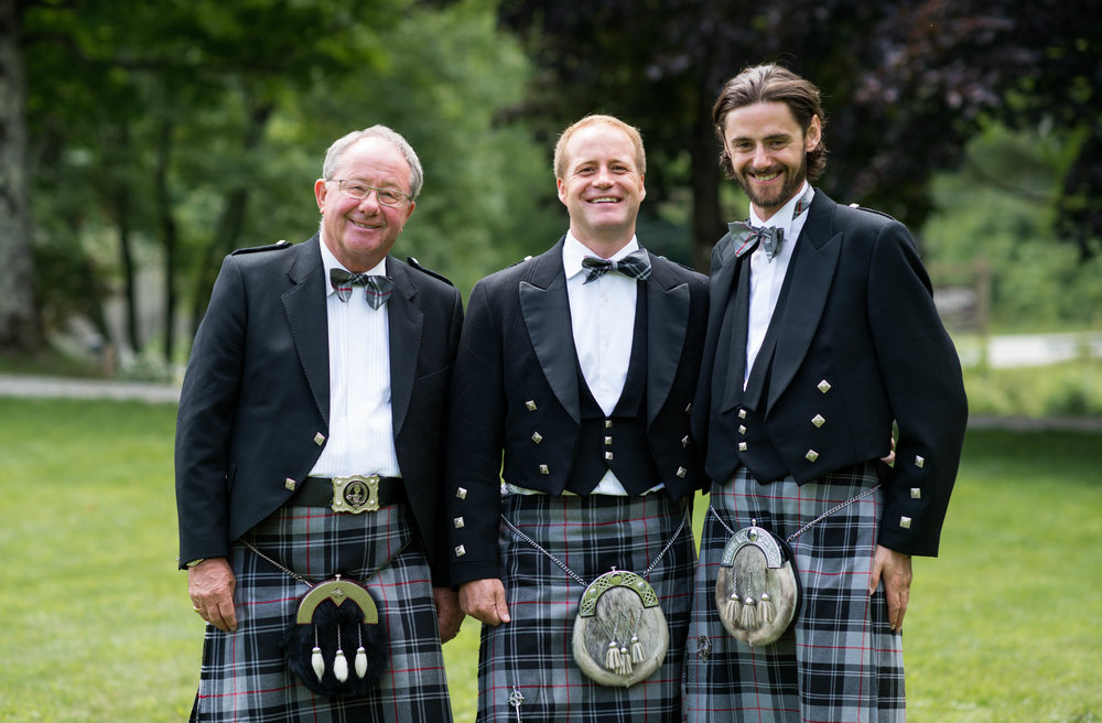 My Dad, brother and cousin wearing Moffat tartan kilts to my wedding.