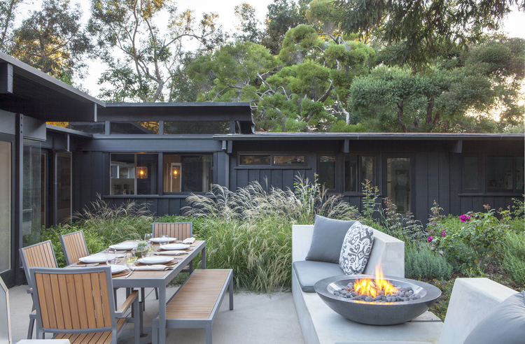 A small fire bowl brings warmth to a patio in our client's home in Rustic Canyon.