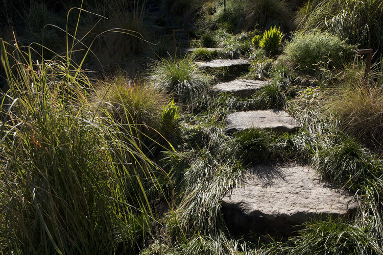 Natural, cut stones integrate into the landscape in an organic way in a way that poured concrete can't match.