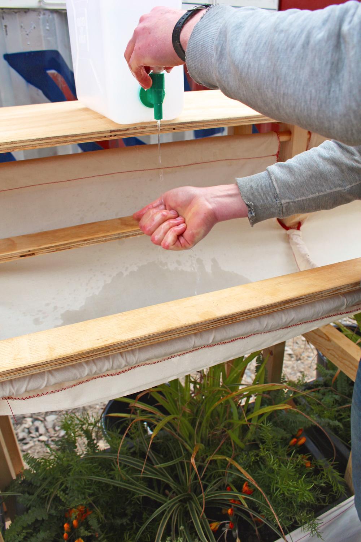 Washing hands, using rainwater