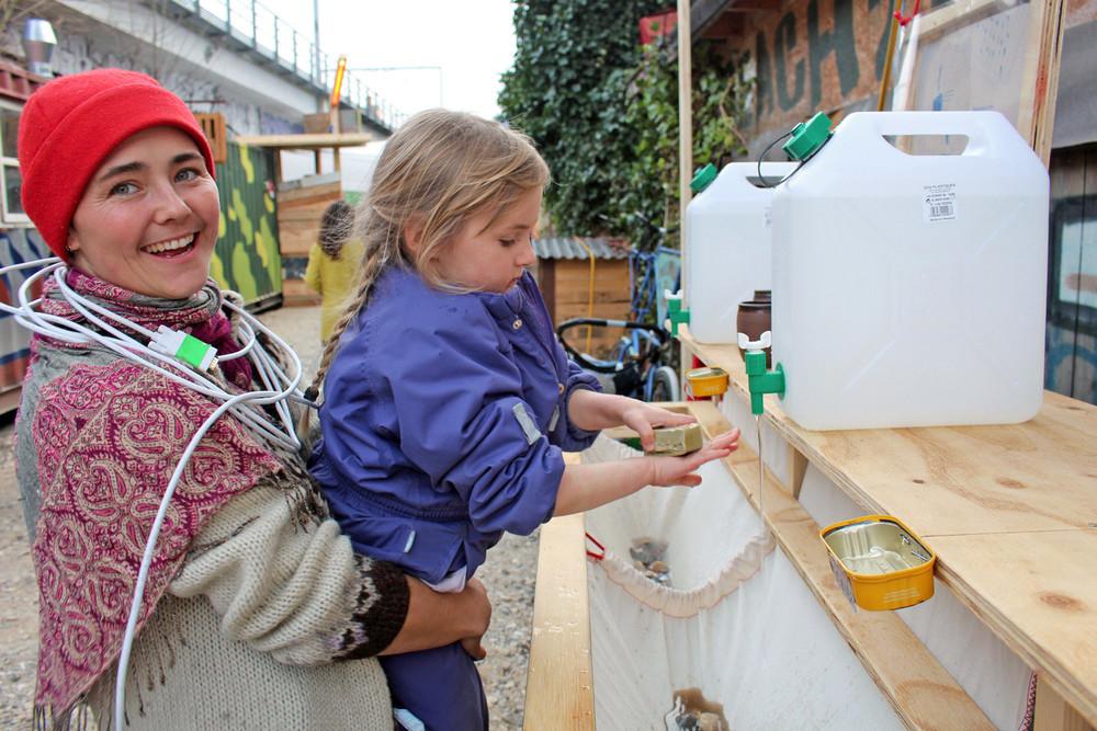 Melina and Wilma washing hands