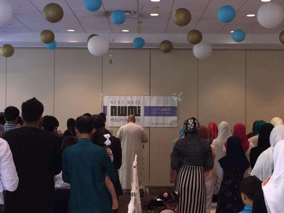 nwmi-eid_prayer_with_barrier.jpg