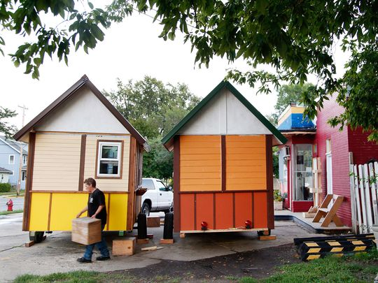 Occupy Madison: Permitted Sleep and Service Hub on private land (church property) in Madision, Wisconsin City Zoning Approval: The Madison Common Council voted to amend the city's zoning code to allow tiny houses, like the single 96-square-foot trailer-mounted cottage Occupy Madison has constructed so far, to be set up on the property of churches and other non-profit organizations.