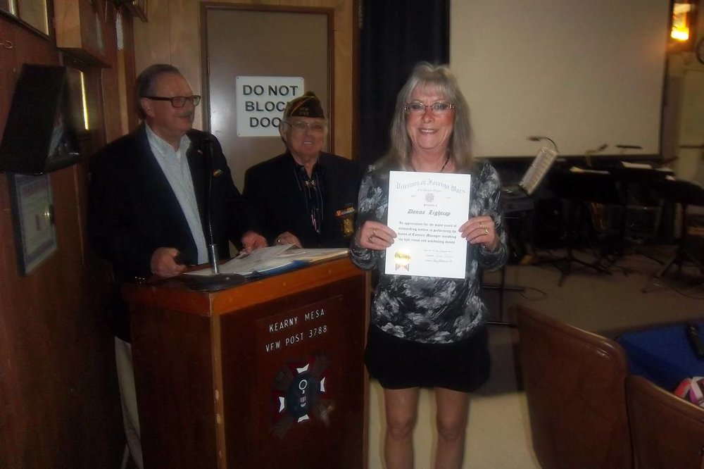 Donna Lightcap receiving a certificate.jpg