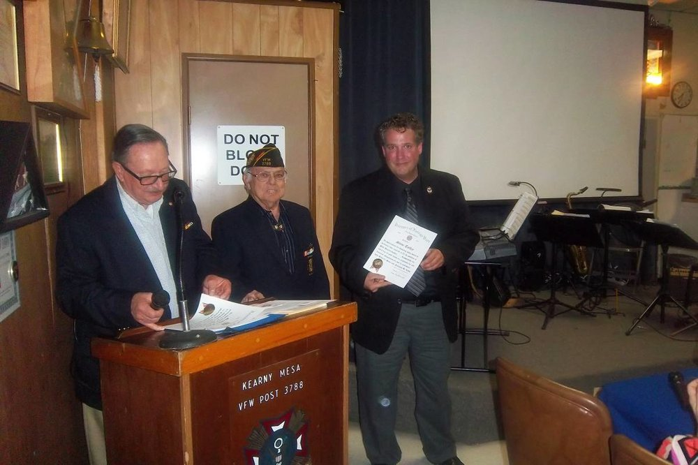 Steve Talley Receiving a certificate.jpg