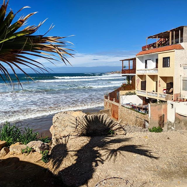 The locals that own the beach-side homes once lived in the mountains but moved to the beach for a better life - maybe they liked surfing 🤔 #surfing #morocco #beach #ocean #beachlife