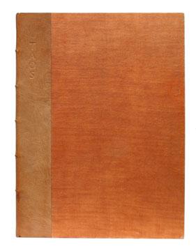 Fine first edition of   Taos Pueblo,  bound in original quarter tan morocco over orange buckram.Grabhorn Press, 1930.