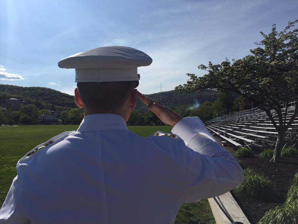 "photo: My oldest son stops to salute the flag being lowered during the sound of ""retreat"" at the end of the day."