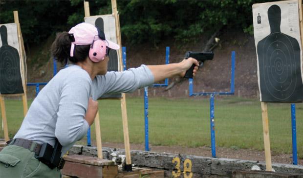 armed-senior-citizen-grasp-handgun-high.jpg