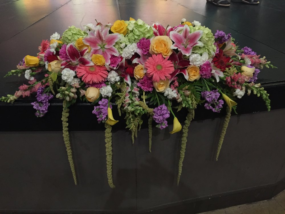 Bright Podium/Sweetheart Table Arrangement