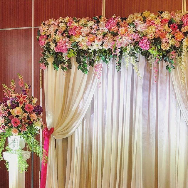 A romantic ceremony setup that doubled as the photo wall.