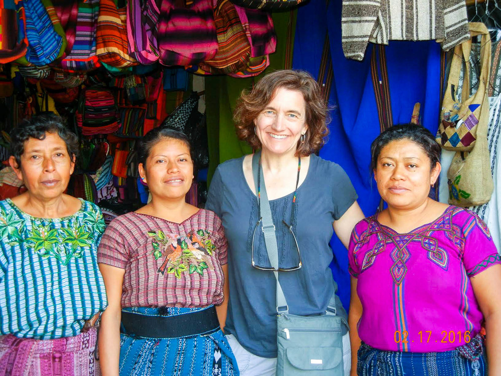 Rebecca center with guatemalan artisans