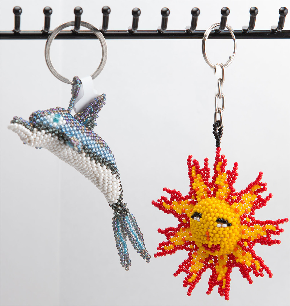 Dolphin or sunburst keychain   $10.00 each