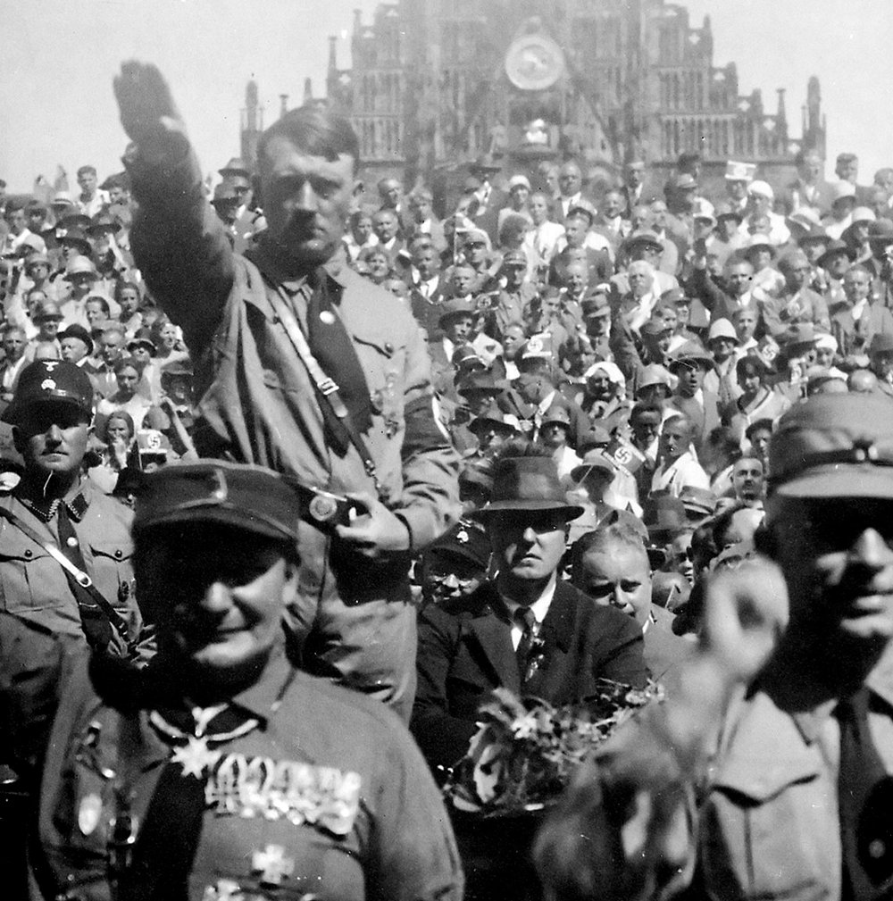 Hitler performing the Nazi Salute (WikiCommons)