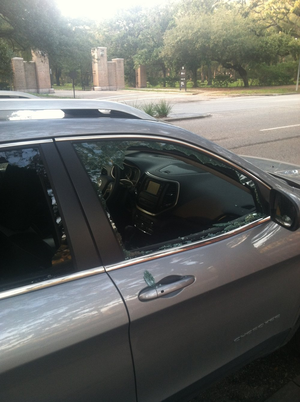 My car and its busted windows. OUCH...