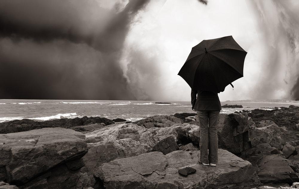 bigstock-girl-with-umbrella-on-the-ocea-53683792.jpg