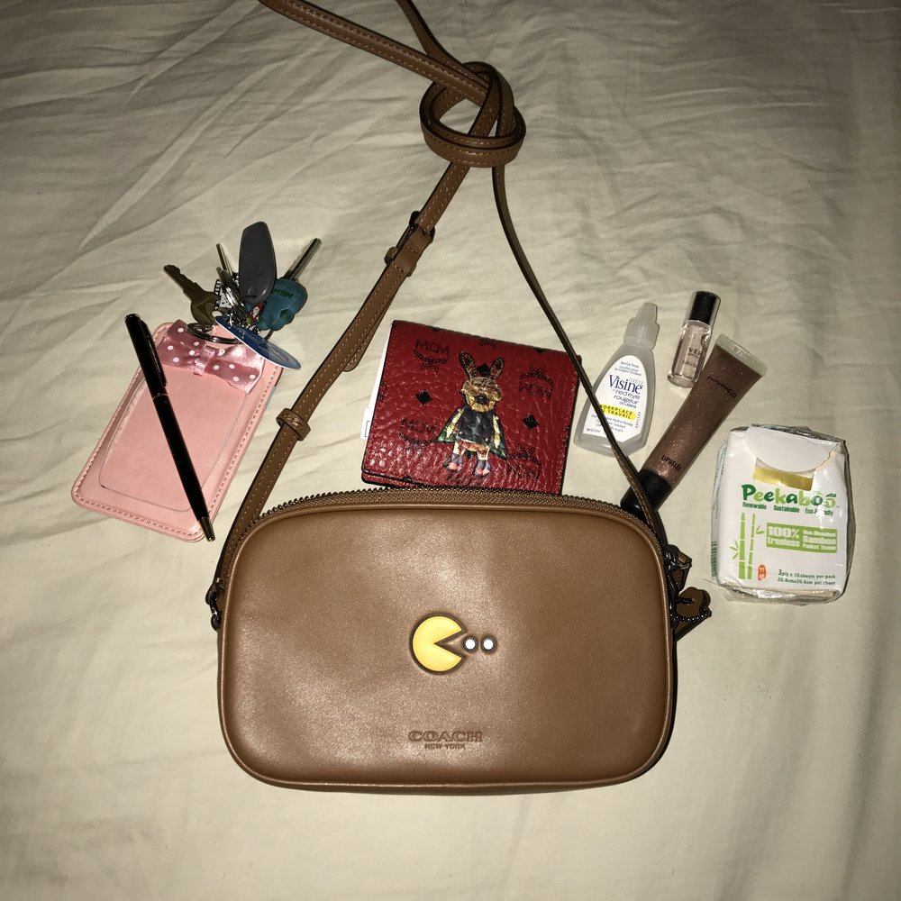 Tranist pass holder which also acts as keychain, mirror and company security pass holder, pen, mini MCM wallet, eye drops, MAC lip shine that I've been trying to use up, mini Versace Bright Crystal perfume (my signature scent), pocket Kleenex, and iPhone 7 plus (used for taking the photo).