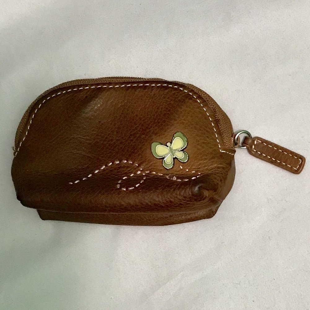 The Fossil key pouch that broke - key holder ripped off when I took a tumble.