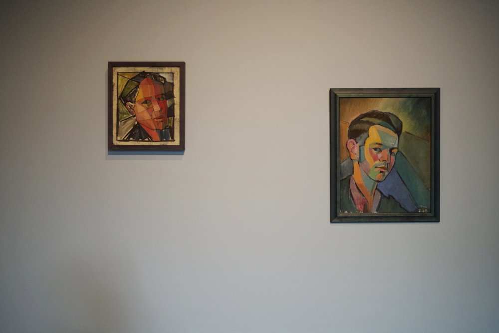 Two self portraits by Melvin Day in the gallery.