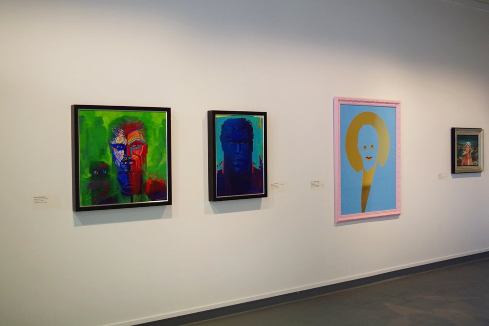 Installation view of Mau Ahua: Portraits by Contemporary Maori Artists. Pictured works by Darcy Nicholas, Ngataiharuru Taepa, and John Walsh.