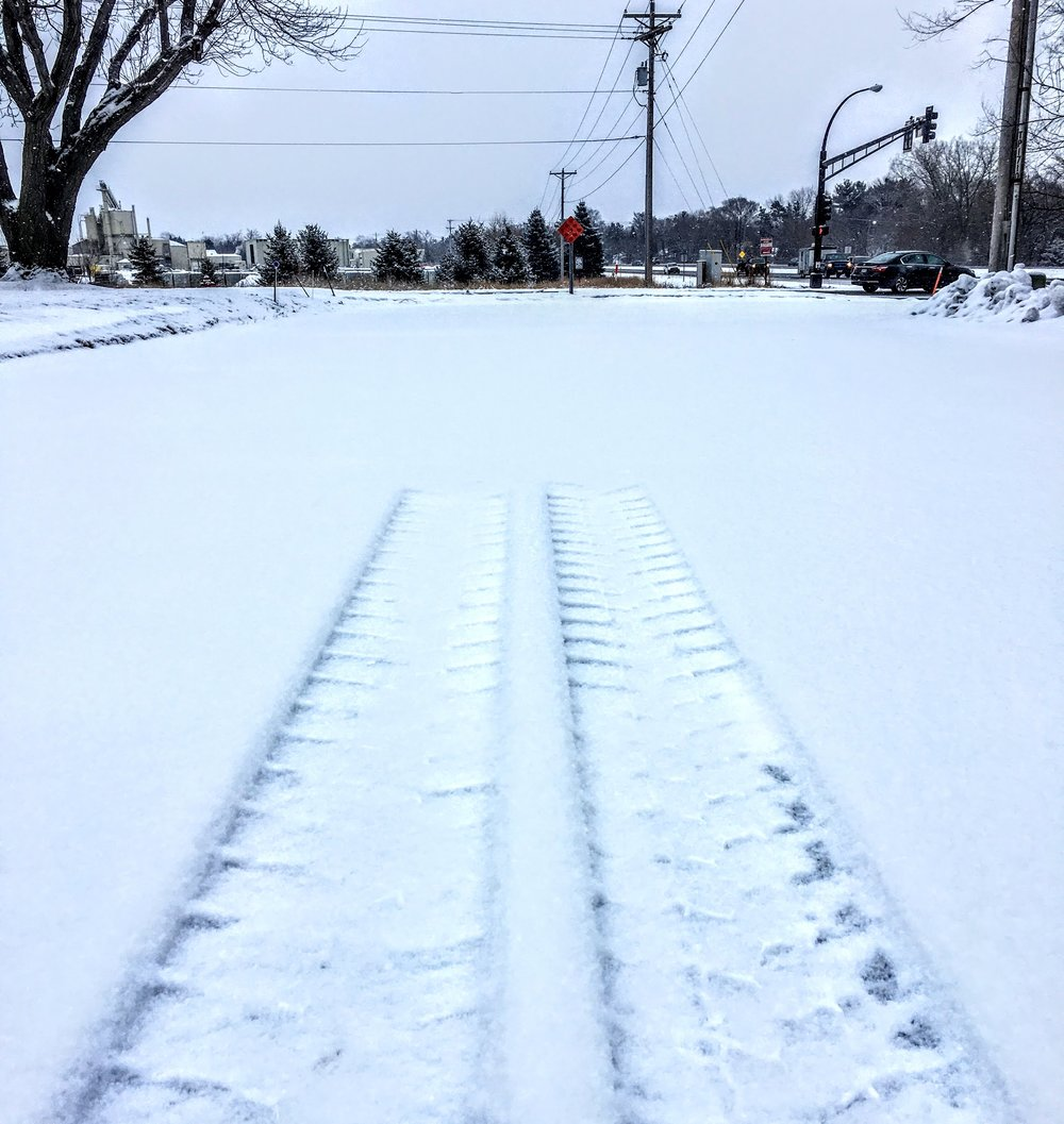 The most recent photo I took while running. I was so intrigued by these tracks that just stopped in the middle of a dead end road. I figured there would be some metaphor that I could use the photo for.