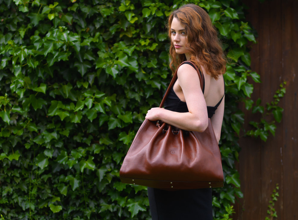 Model shown with Holden Siobhan Large Leather Tote priced at €545.