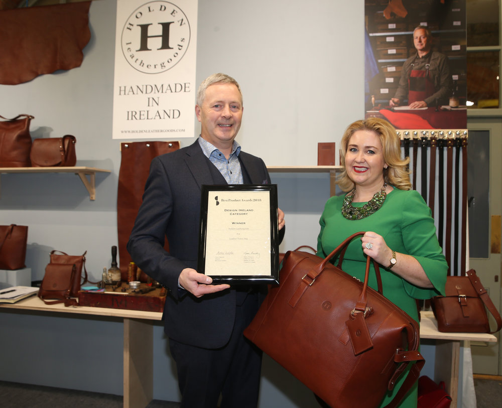 Chief Executive of the Design & Crafts Council of Ireland, Karen Hennessy, pictured with Conor Holden of Holden Leathergoods, this year's winner of the Design & Crafts Council of Ireland Design Ireland Award at Showcase – Ireland's International Creative Expo.  www.showcaseireland.com  Photo credit: Leon Farrell, Photocall Ireland