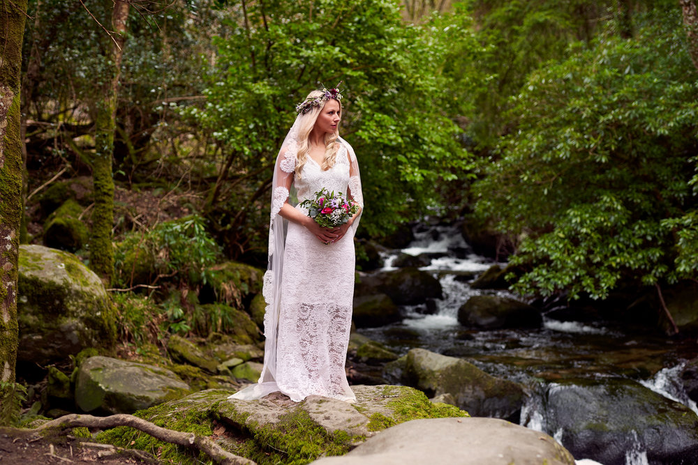 Meave wears a gown by Hazel Comyn and floral crown and bouquet by Maura's Cottage Flowers. Photo : Barry Murphy. Styling : Orla Diffily. This look would be perfect for a contemporary bride who wants something a little different with more traditional elements such as Irish lace, and also for foreign weddings. Photo Credit: Barry Murphy.