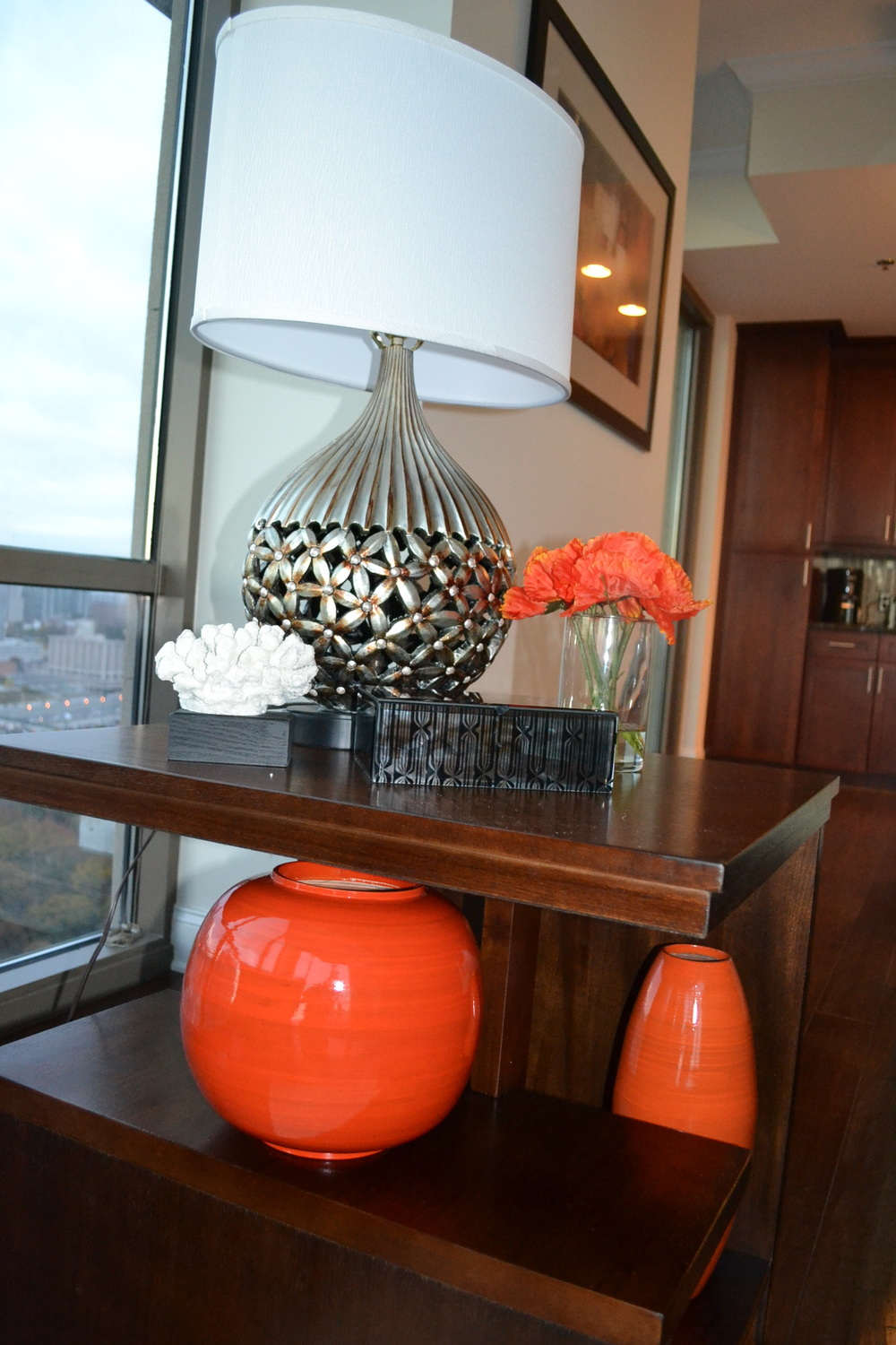 Pops of orange accentuate beautifully staged condo