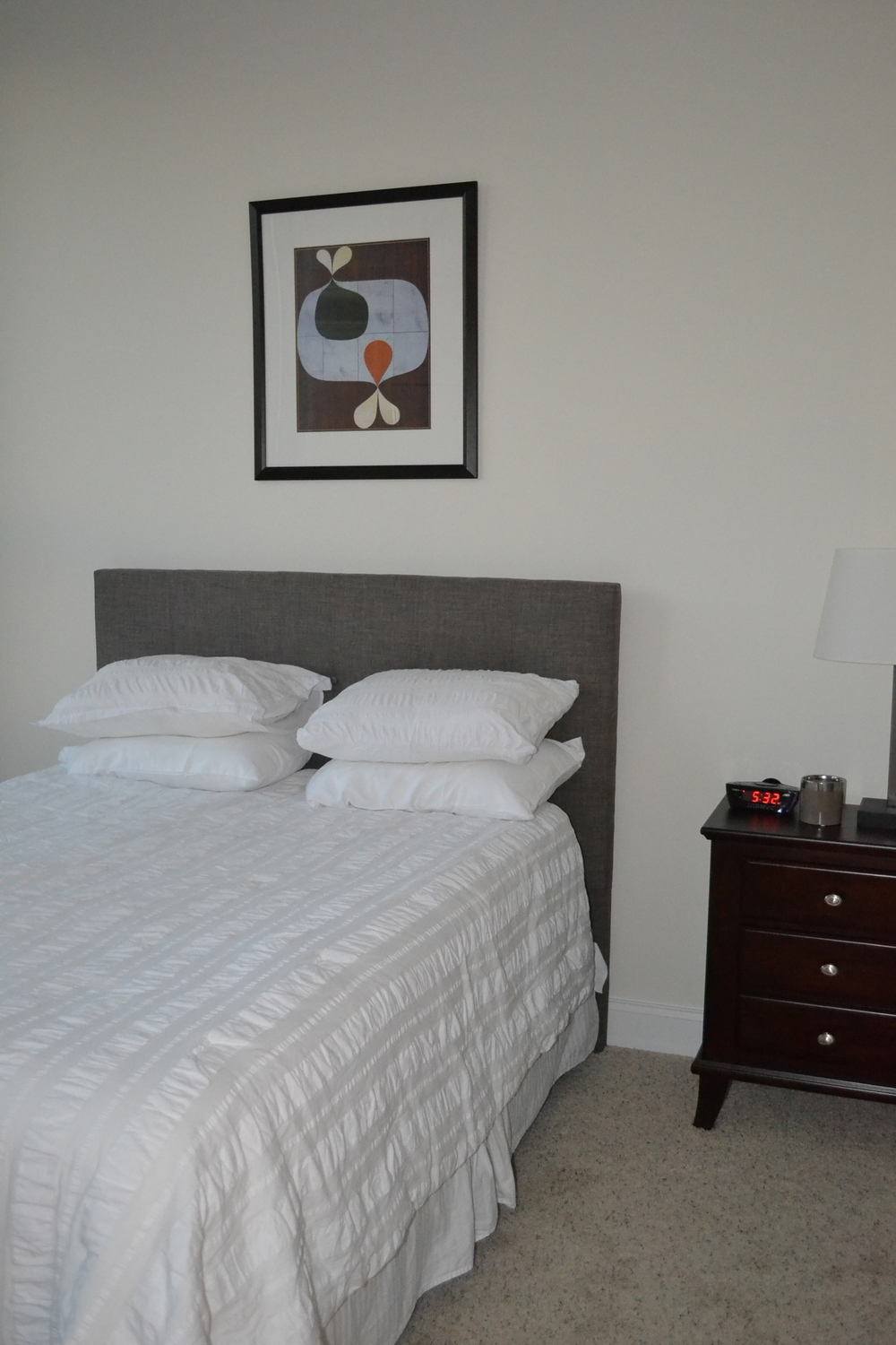 Simple and cozy bedroom makes for a good night sleep in Atlantic Station High-rise condo.