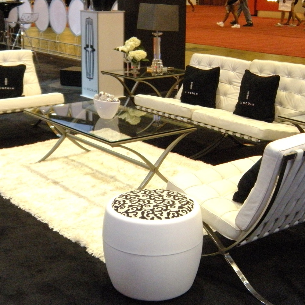 White Leather Barcelona Chairs are a hit in this lounge for Lincoln Motor Company, at Essence Music Festival in New Orleans