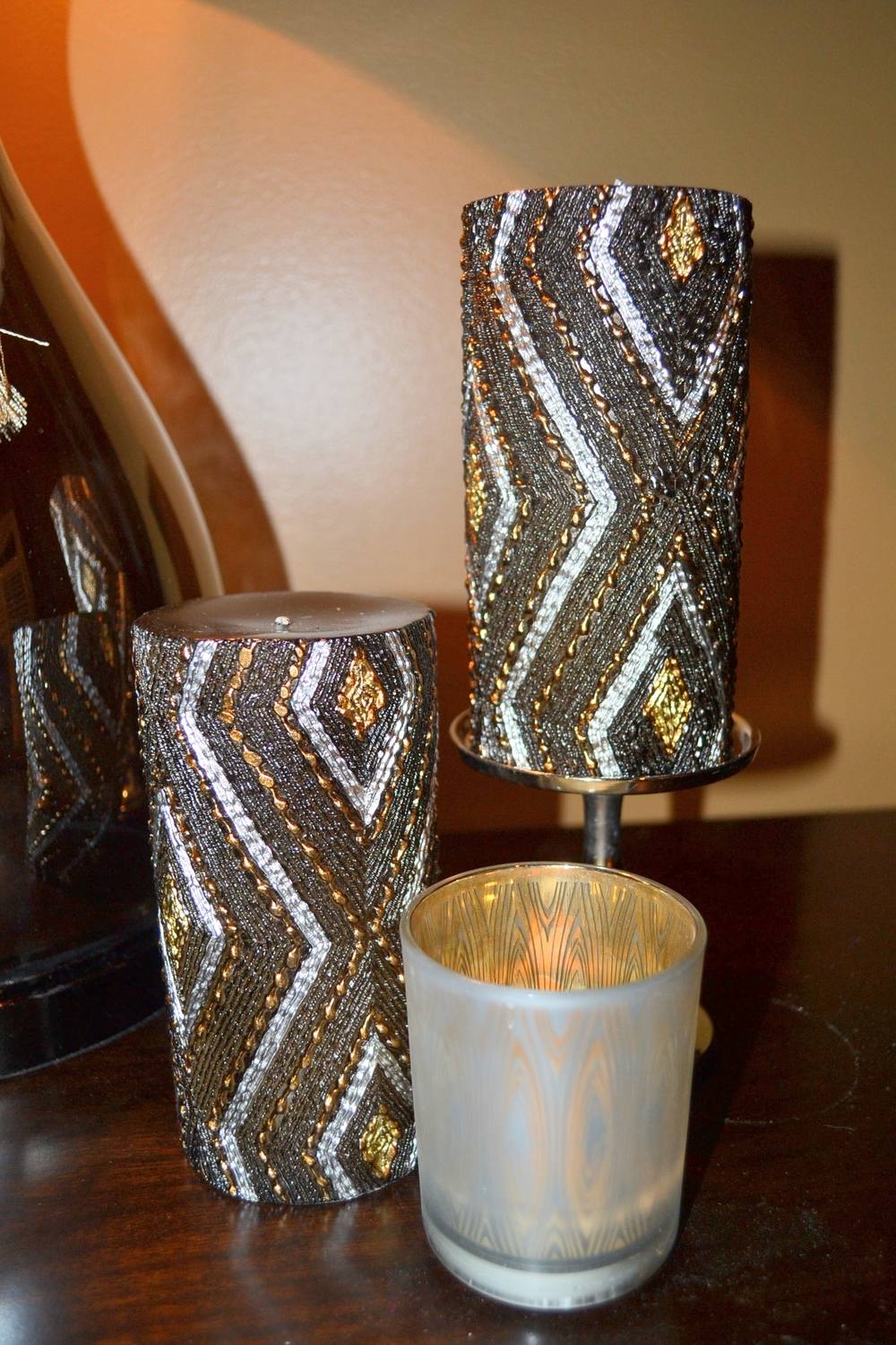 Chocolate, silver, and gold textured candles