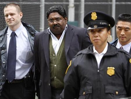 Raj Rajaratnam, a former hedge fund manager, being arrested for insider trading in October 2009. (Image via Reuters)