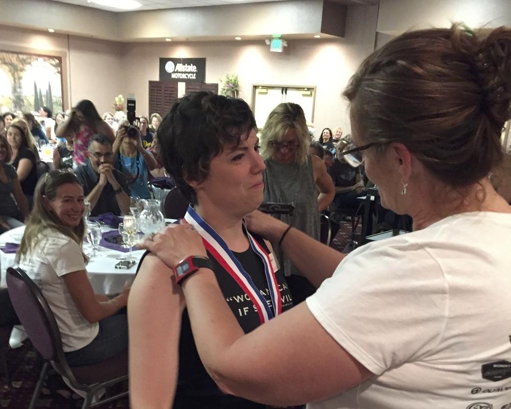 New Rider Sarah Van Buren receives her medal.
