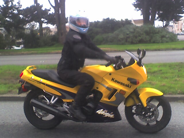 Me on my first ride, a 2003 Kawasaki Ninja 250. Woo woo!