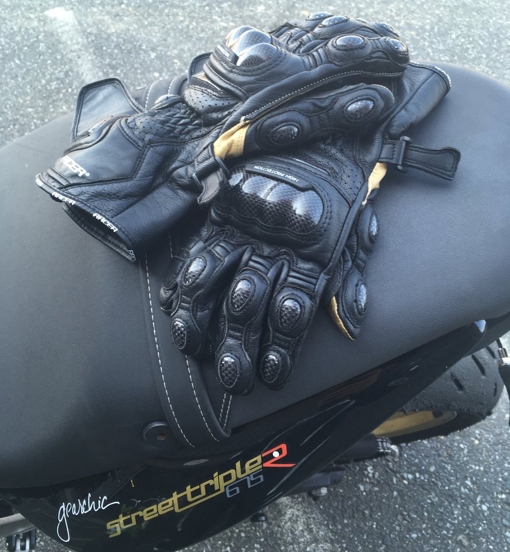 """""""Gauntlets"""" - Racer High Racer Women's GlovesDesigned for track day riding or racing. Also designed for street riding on a sporty bike with a more aggressive precurved finger and tighter fit all around.When you want the most protection you can get, you'll typically get that in a Gauntlet style track glove."""