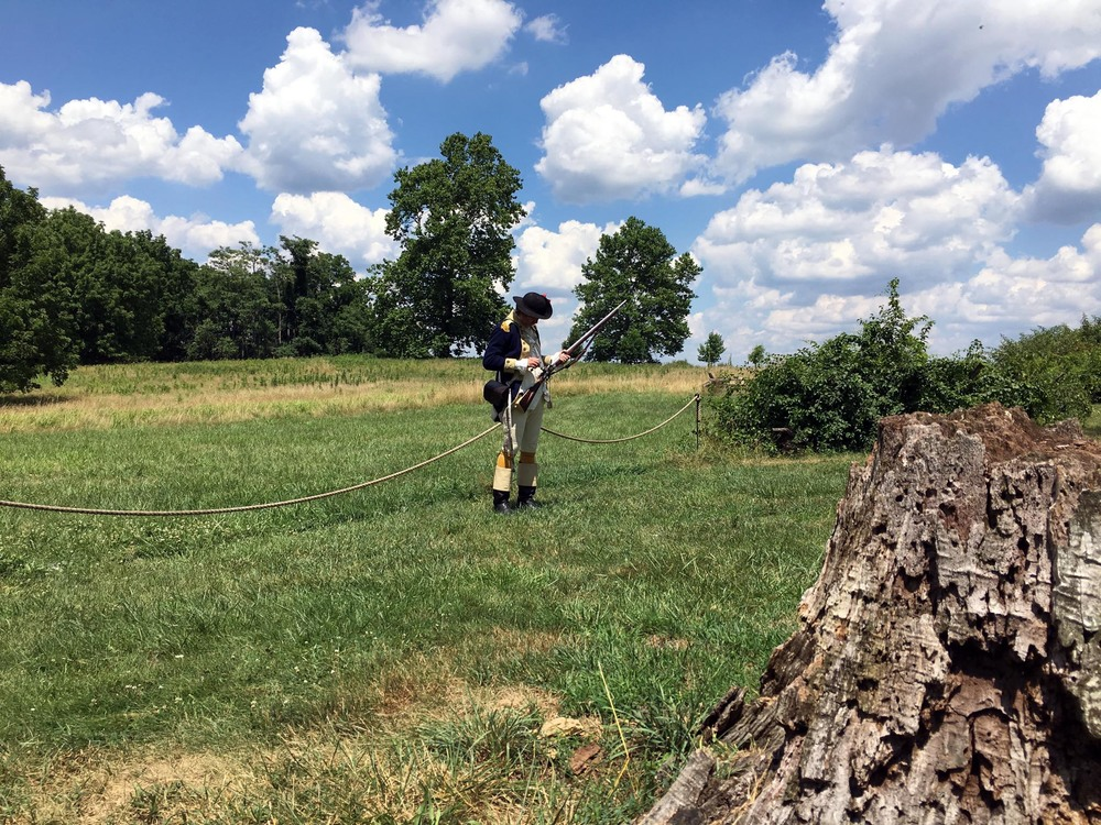 A Once Upon a Nation interpreter offers background on the lives of militia men during the encampment, and also details the workings of the musket.