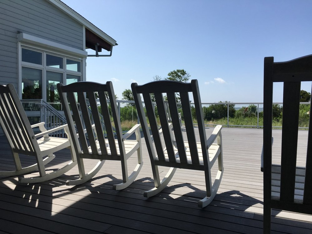 Rocking chairs at the visitor center. Relax at the end of the day, take in the views and birdwatch.