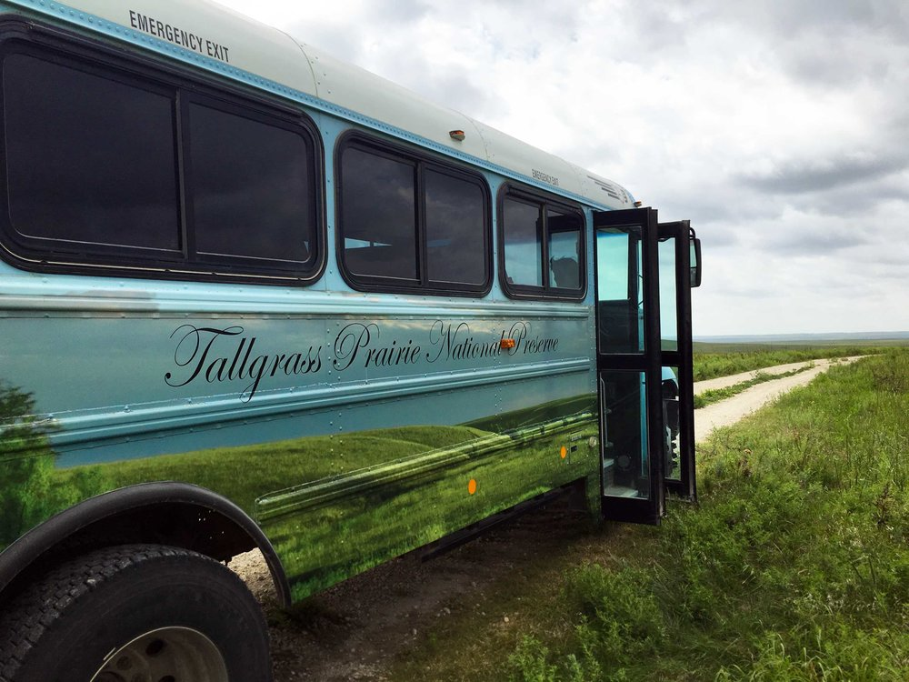 The tour bus and expansive prairie, photo by Derek Wright.