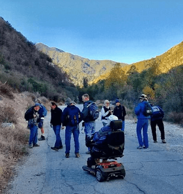 Laura L Mays Hoopes on a Sierra Club hike with her scooter, at the West Fork of the San Gabriel River.