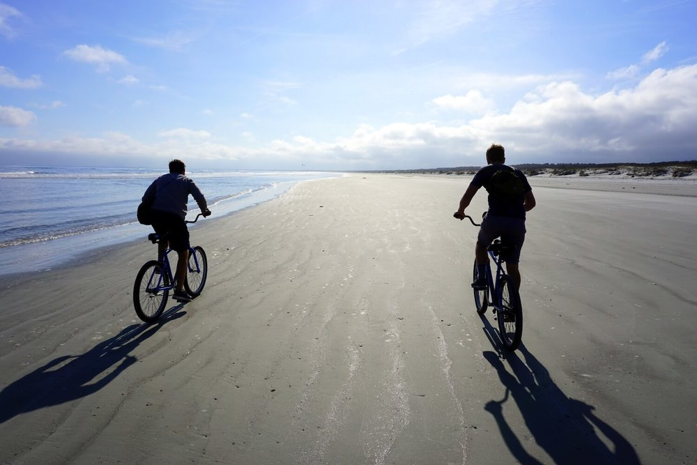 Bicycling on the beach, photo courtesy Lucy Bryan.